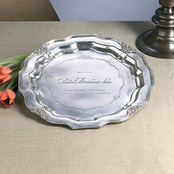 Antique Silver French Charger - Beautifully embossed with French script for an aura of mystery and an allusion to European travel, the Antique Silver French Charger is a superb tray for keys and calling cards on the entryway console or a wall display par excellence.  Deeply recessed between scalloped walls, the central plane has the satin glow of elite silver that has been beautifully cared for until it becomes a treasured heirloom.