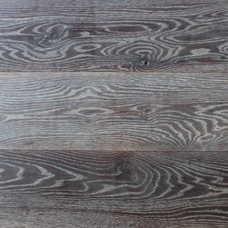 """Grey Oak Floor Planks - 7"""" solid white oak floor planks that are heavily brushed, chemically darken, oxidized and sealed with a hard curing wood floor oil.  The brushing and aging process beautifully contrasts the harder and softer grain in this high quality milled product that exhibits the cathedral grain character that is so desired in the flooring industry.  Vintage Elements offers this finish with all its possible modifications to our customers.  We can apply this finish on either domestic oak or our new or reclaimed French oak floors as well.  This product can also be ordered in engineered flooring with a very thick wear layer for a solid wood floor experience."""