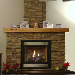 Fireplace Design Concepts - Stacked stone faux panels in Ponderosa provide a facelift for this fireplace as well as create an accent wall over the chimney area.