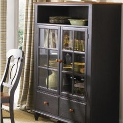 Liberty Furniture Low Country Black Curio Cabinet - The Liberty Furniture Low Country Black Curio Cabinet is a handsome way to showcase your favorite pieces. This striking curio cabinet is well-made of select hardwood solids and cherry veneers in a distressed anchor black with suntan bronzed top. Details include an open shelf above for display two lower drawers for storage and double wood framed glass doors with adjustable shelving. About Liberty FurnitureEstablished in 1993 Liberty Furniture Industries Inc. had seven employees and manufactured wood chairs and laminate table tops in a modest section of a warehouse in west Atlanta. Over the years its scope has widened to include formal and casual dining accent furniture and bedroom furniture. It now operates out of three main facilities in Atlanta one brand-new facility in Chicago and its first Asian office. As Liberty continues to grow it searches for more ways to expand and offer more of what its customers want. Liberty is now one of the premier leaders in manufacturing and delivering quality furniture at exceptional value. Through its growth it has remained a strong family-oriented business that never compromises its values of dedicated customer service a relentless pursuit of quality and a devotion to enriching lives of its employees its customers and its community.