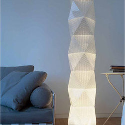 "Rotaliana - Rotaliana | Honey F Floor Lamp - Design by Donegani and Lauda, 2004.Imported from Italy, by Rotaliana.This is a system of light elements built around diffused light, designed on a modular transparent structure, of theoretically unlimited extension, like ""Brancusi's Endless"" column. The texture of the triangular components, in a honey comb structure and micro-prismatic, directs the distribution of the light flow through the interior of the structure. The system is composed of three basic components, assembled together in a clip-on process (the elements are a triangle as diffuser, a square as frame and a crown as the cover) as well as the rod iron legs for the base. The assembly operations, which are extremely simple and require no additional tools, are left to the user. By using the components available in the system, it is possible within the required dimensions, to choose from several lamp alternatives. The floor lamp is available in 4 different standard heights, additional levels can also be purchased.Additional levels can be purchased separately and will add 6.7""H per level."