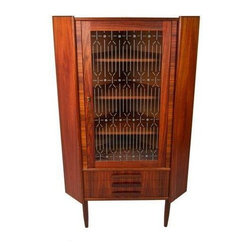 Pre-owned Rare Danish Modern Rosewood Corner Cabinet - A wonderfully compact and stylish piece. This rare Danish Modern rosewood corner cabinet came direct from a small fishing village in Denmark. It features a locking glass door, three shelves to store and display your treasures; and three bottom drawers.