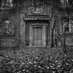"The Door, 16x16"" B&W Fine Art Photograph - Black & White fine art photograph of a door in an apartment building in autumn, with a thick carpet of leaves on the ground. Available as a 16x6"" limited edition fine art photograph. Unframed."