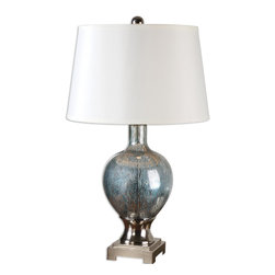 Uttermost - Mafalda Mercury Glass Lamp - Shapely style is yours when you put this unique, Moroccan inspired lamp on your side table. The base is crafted from enchanting mercury blue glass, and features polished chrome-plated details to catch the gleam. The round, white linen hardback shade elevates this lamp to the utmost elegance for your decor.