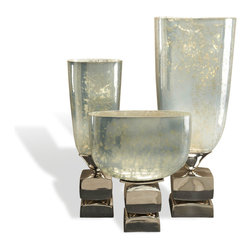 Interlude - Ravello Vases - This wow-worthy trio of glass and aluminum trophy vases bring Hollywood Regency glamour into your favorite eclectic setting. Three different shapes and sizes and a mercury glass effect make them unique toppers for your tabletop or mantel.