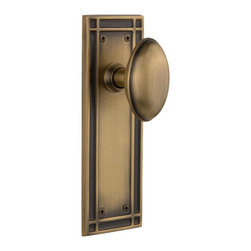 Nostalgic Warehouse - Nostalgic Mission Plate with Homestead Knob in Antique Brass (715814) - The Mission plate in antique brass harkens to the Spanish Colonial period of the Western frontier, with an instantly recognizable square corner. Add our Homestead Knob with its curvaceous oval shape for a look to enhance any home. All Nostalgic Warehouse knobs are mounted on a solid (not plated) forged brass base for durability and beauty.