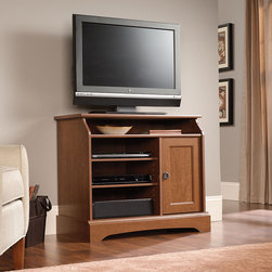 "Sauder - Graham Hill 35"" TV Stand - Inspired by heirloom country pieces, the Graham Hill collection combines timeless charm with modern functional flair. A warm Autumn Maple finish is enhanced by the high gloss richness of the Sunset Granite finish tops. Swept back forms, custom designed Arts and Crafts inspired hardware and framed panel doors speak to authenticity. Every piece, from the desk to the entertainment credenza, is designed with attention to functionality and built to accommodate new modern technologies from flat panel televisions to laptops, making it easy to bring a little country home with Graham Hill. Features: -Holds TVs weighing 135 lbs or less; base must be no larger than 35 inches.-Open shelf and two adjustable shelves hold audio/video equipment.-Raised panel door.-Autumn Maple finish.-Graham Hill collection.-Recommended TV Type: Flat.-TV Size Accommodated: 35"".-Finish: Autumn Maple.-Powder Coated Finish: No.-Gloss Finish: No.-Material: Engineered wood.-Solid Wood Construction: No.-Distressed: No.-Exterior Shelves: Yes.-Drawers: No.-Cabinets: Yes -Number of Cabinets: 1.-Number of Doors: 1.-Door Attachment Detail: Hinges.-Interchangeable Panels: No.-Magnetic Door Catches: Yes.-Cabinet Handle Design: Knobs.-Number of Interior Shelves: 2.-Adjustable Interior Shelves: Yes..-Scratch Resistant: No.-Removable Back Panel: No.-Hardware Finish: Bronze.-Casters: No.-Accommodates Fireplace: No.-Lighted: No.-Media Player Storage: Yes.-Media Storage: Yes.-Cable Management: Cable hole.-Remote Control Included: No.-Weight Capacity: 135 lbs.-Swatch Available: Yes.-Commercial Use: No.-Collection: Graham Hill.-Eco-Friendly: Yes.-Recycled Content: No.-Lift Mechanism: No.-Expandable: No.-TV Swivel Base: No.-Integrated Flat Screen Mount: No.-Non-Toxic: Yes.-Product Care: Wipe with a damp cloth.-Country of Manufacture: United States.Specifications: -Storage area behind door features an adjustable shelf and holds 22 cardboard case VHS tapes, 18 oversized case VHS tapes, 44 DVDs or 56 CDs.-ISTA 3A Certified: Yes.-CARB 2 Certified: Yes.-CARB Certified: Yes.-FSC Certified: Yes.-General Conformity Certified: Yes.-EPP Certified: Yes.Dimensions: -Overall Height - Top to Bottom: 30.039"".-Overall Width - Side to Side: 35.039"".-Overall Depth - Front to Back: 18.701"".-Drawer: No.-Shelving: Yes.-Cabinet: Yes.-Legs: Yes.-Overall Product Weight: 76 lbs.Assembly: -Assembly Required: Yes.-Tools Needed: Phillips screwdriver and hammer.-Additional Parts Required: No.Warranty: -Product Warranty: 5 Years."