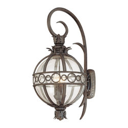 "Troy - Campanile Collection 35 1/2"" High Outdoor Wall Light - The Campanile outdoor collection from Troy Lighting is bursting with Mediterranean beauty and charm. This spectacular design is crafted from hand-forged iron and features classic acanthus leaf details. The frame presented in a Campanile bronze finish surrounds a center of clear seedy glass which gracefully displays the glowing fixtures within. A wonderful design for lighting your outdoor spaces. Hand-forged iron construction. Campanile bronze finish. Clear seedy glass. Takes four 60 watt candelabra bulbs (not included). 35 1/2"" high. 16 3/4"" wide. Extends 20 1/2"" from the wall. 20 1/2"" from mounting point to top.  Hand-forged iron construction.   Campanile bronze finish.   Clear seedy glass.   Takes four 60 watt candelabra bulbs (not included).   35 1/2"" high.   16 3/4"" wide.   Extends 20 1/2"" from the wall.   20 1/2"" from mounting point to top."