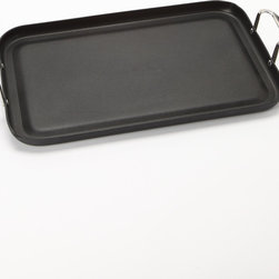 Maverick - 20'' Double Griddle - Cook for a crew with this double griddle that covers two burners and features sturdy riveted handles. Its hard anodized aluminum construction ensures quick and even heat distribution, while a nonstick coating means easy release and cleanup.   20'' W x 13'' H Nonstick coated anodized aluminum / stainless steel Hand wash Imported