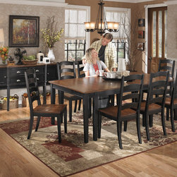 "Ashley Owingsville Dining Room Collection - The rich cottage beauty of the ""Owingsville"" Dining Collection uses a rich medium brown finish on chair seats and table tops contrasting the painted black color of the table base and chair legs to create a stylish two-tone cottage look that is sure to add a warm inviting atmosphere to any dining area."