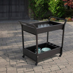 None - Sirio Hand-crafted Resin Wicker Outdoor Serving Cart with Glass Top - This functional and stylish two-shelf wicker serving cart makes outdoor dining so much better. With its glass top,two shelves,sturdy casters and room for storing beverages and utensils,youll glad you have it. Made with quality,durable materials.
