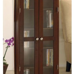 Alana DVD/CD Cabinet - Store your CDs and DVDs in elegant style in the Alana DVD/CD Cabinet. Beautifully styled with a traditional profiled trim this cabinet features beveled detail on the base and top edge. Crafted from solid wood it has a warm antique walnut finish clear glass door inserts and metal hardware in a satin nickel finish. Five adjustable shelves offer storage for up to 135 DVDs 205 CDs or 75 videocassettes. Dimensions: 22L x 9.25W x 44.2H inches.About Winsome TradingWinsome Trading has been a manufacturer and distributor of quality products for the home for more than 30 years. Specializing in furniture crafted of solid wood Winsome also crafts unique furniture using wrought iron aluminum steel marble and glass. Winsome's home office is located in Woodinville Wash. The company has its own product design and development team offering continuous innovation.