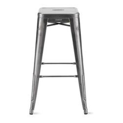 """Tolix - Tolix Marais Counter Stool - Metalworker Xavier Pauchard not only brought the art of galvanizing steel to France, but took the process to the next level by creating the Marais A Chair (1934), the quintessential cafe chair that was both elegant and robust enough to grace the decks of the S.S. Normandie ocean liner. """"Xavier Pauchard's Chaise A is a perfect synthesis created by a man possessed of an understanding of raw materials - and the tools used to work them,"""" said Serge Lemoine, former director of Musee d'Orsay, Paris. The Collection expanded to stools as well, and all Tolix metal furniture is still made in Autun, the same Burgundy town where it all began. Slight surface abrasions and markings are characteristic of the material and part of its hardworking machine aesthetic. Rubber feet prevent damage to floors. The Marais Collection will stand up to the rigors of public use, but should be protected from wet weather conditions to maintain the finish. Stackable up to 8 high. Made in France.  Colors are DWR Exclusive."""