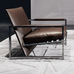 Atlan Armchair - If modern is your style and you are looking for that signature furniture piece to add the WOW factor, this striking armchair designed by Rodolfo Dordoni would be a brilliant selection.