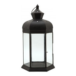 Midnight Lantern, Tall - The matte black finish on this classic lantern adds a modern edge. I could see it working with many styles: modern, nautical, vintage and more.