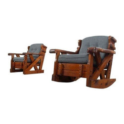 """Pre-owned Vintage Knotty Pine Lounge Chairs - A Pair - Pair of vintage solid pine rustic lounge chairs. Both chairs newly upholstered in slate colored tweed fabric. Set includes one rocking chair and one stationary arm chair. Marvels of American furniture manufacturing. Steadfastly constructed with solid knotty pine wood. Dark walnut color stain adds richness (original). Thick cushions suit today's standard for comfort.     This listing is for the two chairs pictured. Matching sofa, bench ottoman and side chairs are sold separately. New upholstery. No outstanding wear on wood frame.     Arm chair: 33.5"""" Wide x 28.5"""" Deep x 33.5"""" High (17"""" seat height)  Rocking chair: 33.5"""" Wide x 32.5"""" Deep x 28.5"""" High (19"""" seat height)"""