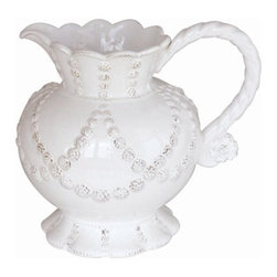 """Juliska - Juliska Jardins du Monde Garland Pitcher Whitewash - Juliska Jardins du Monde Garland Pitcher Whitewash.This romantic pitcher is draped with garlands and edged with feminine scallops that would make it right at home at Le Petit Trianon. Fill with roses plucked from arbors or cream at teatime for a look that is rustically beautiful. Dimensions: 8.5"""" H Capacity: 2.25 Qt"""