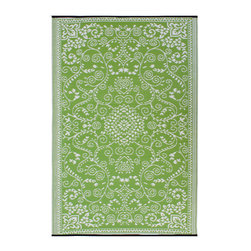Fab Habitat - Murano Rug, Lime Green & Cream - Drink it in. The soft colors and classic styling of this rug look so traditional you almost won't believe how it's made. Woven from recycled plastic straws, it's ecofriendly, stain and mildew resistant, reversible, easy to clean and works equally well inside or out.