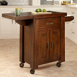 Home Styles - Home Styles Cabin Creek 1 Drawer Drop Leaf Kitchen Cart Multicolor - 5411-95 - Shop for Carts from Hayneedle.com! The Home Styles Cabin Creek 1 Drawer Drop Leaf Kitchen Cart is perfect for food prep and it looks attractive for serving as well. This portable kitchen cart features a durable wood countertop which is an ideal surface for food preparation. By simply raising the drop-leaf on the side you can extend the cart's width from 38.25 inches to 48 inches. Constructed of mahogany solids and veneers in a multi-step heavily distressed chestnut finish this versatile cart boasts a reclaimed wood/vintage feel hand-distressing for a one-of-a-kind look and replicated hand-forged hardware. The storage drawer is the perfect place for spices or cooking utensils and the spacious cabinet has an adjustable shelf for for pots and pans bowls and more. The built-in towel bar keeps towels in easy reach and industrial casters with rubber wheels allow you to easily move this cart wherever you need it. About Home StylesHome Styles is a manufacturer and distributor of RTA (ready to assemble) furniture perfectly suited to today's lifestyles. Blending attractive design with modern functionality their furniture collections span many styles from timeless traditional to cutting-edge contemporary. The great difference between Home Styles and many other RTA furniture manufacturers is that Home Styles pieces feature hardwood construction and quality hardware that stand up to years of use. When shopping for convenient durable items for the home look to Home Styles. You'll appreciate the value.