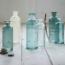 Recycled Glass Jugs, Turquoise - Line the center of the table with recycled bottles filled with a bloom or two.
