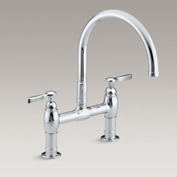 "KOHLER - KOHLER Parq(R) two-hole deck-mount kitchen sink faucet with 9"" gooseneck spout a - This Parq kitchen faucet delivers a fresh interpretation of the traditional bridge design, incorporating clean lines for ease of maintenance. The high-arch gooseneck swing spout provides generous clearance over pots and pans, while the ergonomic lever han"
