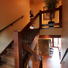 Traditional Staircase by Pinnacle Mountain Homes