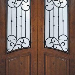 "Slab Entry Double Door 96 Wood Alder Catalina Arch Lite Wrought Iron - SKU#E93662WCTBrandGlassCraftDoor TypeExteriorManufacturer CollectionArch Lite Entry DoorsDoor ModelCatalinaDoor MaterialWoodWoodgrainKnotty AlderVeneerPrice3500Door Size Options2(36"") x 96"" (6'-0"" x 8'-0"")  $0Core TypeDoor StyleSquare TopDoor Lite StyleArch LiteDoor Panel StyleHome Style MatchingDoor ConstructionEstanciaPrehanging OptionsSlabPrehung ConfigurationDouble DoorDoor Thickness (Inches)1.75Glass Thickness (Inches)Glass TypeDouble GlazedGlass CamingGlass FeaturesTemperedGlass StyleGlass TextureWater , Flemish , Baroque , Fluted , Rain , Glue Chip , ClearGlass ObscurityLight Obscurity , Moderate Obscurity , Highest Obscurity , No ObscurityDoor FeaturesDoor ApprovalsWind-load Rated , SFI , TCEQ , AMD , NFRC-IG , IRC , NFRC-Safety GlassDoor FinishesDoor AccessoriesWeight (lbs)575.2Crating Size25"" (w)x 108"" (l)x 52"" (h)Lead TimeSlab Doors: 7 daysPrehung:14 daysPrefinished, PreHung:21 daysWarrantyOne (1) year limited warranty for all unfinished wood doorsOne (1) year limited warranty for all factory?finished wood doors"
