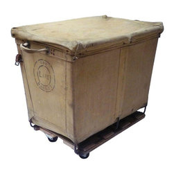 Pre-owned Industrial Laundry Basket - Stay on trend with our vintage industrial laundry basket on wheels.  You could use it for laundry, but we'd try using it for toss pillows, throw blankets, and vintage textiles.