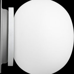 Flos Lighting - Glo-Ball Mini Ceiling/Wall by Flos Lighting - The Flos Glo-Ball Mini Ceiling/Wall is the petite model within the collection of popular glowing orbs designed by Jasper Morrison. As part of this collection, the Mini features a hand-blown, acid-etched and flashed Opaline glass shade. The lightweight injection-molded PPS base makes the Mini able to be easily installed on either the wall or ceiling.Flos was first established in 1962 in Merano, Italy, to produce high quality modern lighting. This Italian lighting company continues to do so to this day by collaborating with talented international designers and researching the latest lighting technologies and materials. Resulting Flos lighting fixtures are daring and provocative, yet uphold the fundamental principles of good design.The Glo-Ball Mini Ceiling/Wall is available with the following:Details:Hand-blown, acid-etched, flashed Opaline glass shadeInjection-molded PPS baseRound wall plate/ceiling canopyCan be installed on ceiling or wallADA Compliant when installed on wallUL ListedMade in ItalyDesigned by Jasper MorrisonLighting:One 25 Watt 120 Volt G9  Halogen lamp (included).Shipping:This item usually ships within 3 to 5 business days.