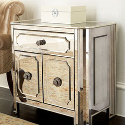 """Logan"" Mirrored Chest - Add a touch of glamour and beauty to your home with the Logan"" Mirrored Chest.  Place this piece bedside and store your favorite bedtime reading behind the double doors.    * Made of hardwood solids with mirrored veneers.    * Silver-leaf trim.    * Antiqued silver hardware.    * 30""W x 17""D x 29""T."