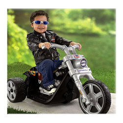 Fisher-Price - Power Wheels Harley-Davidson Ride On Toy - Features: -Rocker. -Includes 6-volt battery and charger. -Recommended for outdoor use only. -Realistic styling and eco-friendly. -Push-button operation for easy stop and go. -A clicking speedometer dial and a Harley-Davidson Rocker inspired solo saddle seat. -Wide and stable 3-wheel low rider base for easy on and off. -Six-volts of battery power drives and exciting 2 mph (max. forward) on hard surfaces and grass. - Suitable for ages 18 months - 4 years.