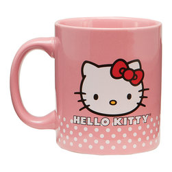Hello Kitty - Hello Kitty Ceramic Mug - Hello Kitty isn't just for kids—she also makes the perfect tea and coffee companion well into adulthood. These charming dishwasher-safe mugs will always add a nostalgic smile to a sip of chamomile or French Roast.   4.75'' H x 3.75'' diameter Holds 12 oz. Ceramic Microwave and dishwasher safe Imported