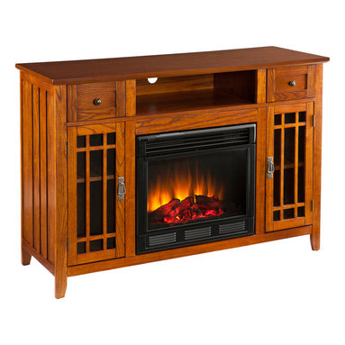 SEI - Salinas Electric Media Fireplace - Mission - This versatile media fireplace is as lovely as it is practical. The earthy, oak finish and mission design pair with multipurpose storage options in the ultimate media fireplace. To top it off, this fireplace requires no electrician or contractor for installation, allowing for instant remodeling without the usual mess or expenses. This mission fireplace features one open shelf for electronic components, two drawers for storing all the extras, and two window pane cabinets for movies, games, or any prized possession. The cabinet doors have a simple, mission design layered atop the glass; each cabinet features one fixed and one adjustable shelf to accommodate a variety of needs. The side panels of this media fireplace also feature mission panels for a well-rounded look. The electric fireplace insert requires no permanent wiring or ventilation - simply plug it into any wall outlet and enjoy the romance of a realistic fireplace. The electric insert features realistic flickering flames and glowing embers - brightness of each can be adjusted with a simple push of a button. In addition to adjusting the thermostat, the electric fireplace also offers the option of using with or without heat for year-round enjoyment. Convenience and ease of assembly are just two of the reasons why this fireplace is perfect for your home. The warm, mission style of this media fireplace works well in transitional to contemporary homes, as well as with lodge and Southwest decors. This contemporary fireplace is great for the living room and bedroom, and even adds a warm, romantic touch to the home office. Let this beautiful, functional fireplace give your home a more welcoming and enjoyable atmosphere.