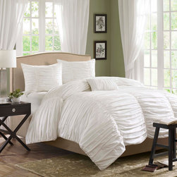 Madison Park - Madison Park Delancey Comforter Set - The Delancey bed set is where fun meets comfort. The entire top of the comforter is rouched fabric that makes it look billowy and soft while there are seams down the length of it to provide structure and gives the illusion of a scalloped edge to the end of the bed. This comforter is made from 100% cotton and the reverse is a soft, brushed micro-fiber; making it eye-catching on the top and provide that comfortable feeling you need on the back. COMFORTER, Face: 100% cotton, reverse: 100% polyester, filling�__100% polyester; SHAM, Face: 100% cotton, reverse: 100% polyester; PILLOW, Cover:100% Cotton, Filling:100% Polyester.