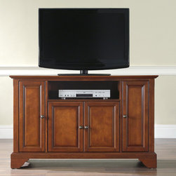 "Crosley - LaFayette 48"" TV Stand - Enhance your living space with one of Crosley's impeccably-crafted TV stands. This signature cabinet accommodates most 52'' flat panel TVs and is handsomely proportioned featuring character-rich details sure to impress. Raised panel doors strategically conceal stacks of CDs/DVDs, gaming components and various media paraphernalia. Open storage area generously houses media players and the like. Adjustable shelving offers an abundance of versatility to effortlessly organize by design, while cord management systems tame the unsightly mess of tangled wires. Customize our distinct cabinets by selecting one of four collection styles (featuring tapered, traditional. turned or bun feet) in your choice of one of three signature Crosley finishes. This customizable cabinet approach is designed for easy assembly, built to ship and constructed to last. Features: -Raised panel doors.-Five adjustable shelves for storing electronic components, gaming consoles, DVDs and other items.-Adjustable levelers in legs.-Recommended TV Type: Flat screen.-TV Size Accommodated: 48"".-Powder Coated Finish: No.-Gloss Finish: No.-Material: Hardwood and veneers.-Solid Wood Construction: No.-Distressed: No.-Exterior Shelves: Yes -Number of Exterior Shelves: 1.-Adjustable Exterior Shelves: No..-Drawers: No .-Cabinets: Yes -Number of Cabinets: 3.-Number of Doors: 4.-Door Attachment Detail: Pin hinge.-Interchangeable Panels: No.-Magnetic Door Catches: Yes.-Cabinet Handle Design: Knob.-Number of Interior Shelves: 5.-Adjustable Interior Shelves: Yes..-Scratch Resistant : No.-Removable Back Panel: No.-Hardware Finish (Finish: Black): Brushed nickel knobs, steel hardware.-Hardware Finish (Finish: Classic Cherry, Vintage Mahogany): Antique brass knobs, steel hardware.-Casters: No .-Accommodates Fireplace: No.-Fireplace Included: No .-Lighted: No .-Media Player Storage: Yes.-Media Storage: No .-Cable Management: Hole in back for wires.-Remote Control Included: No.-Batteries Required: No .-Weight Capacity: 200 lbs.-Swatch Available: No.-Commercial Use: No.-Collection: Alexandria.-Eco-Friendly: No.-Recycled Content: No .-Lift Mechanism: No.-Expandable: No.-TV Swivel Base: No.-Integrated Flat Screen Mount: No.-Hardware Material: Steel.-Product Care: Use a soft clean cloth that will not scratch the surface when dusting. Use of furniture polish is not necessary. Should you choose to use a furniture polish, test in an inconspicuous area first. Use os solvents of any kind could damage your furniture's finish. To clean, simply use a soft cloth moistened with lukewarm water, then buff with a dry soft clean cloth..Specifications: -ISTA 3A Certified: Yes.-FSC Certified: No.-General Conformity Certified: No.-CSA Certified: No.-EPP Certified: No.Dimensions: -Overall Height - Top to Bottom: 30"".-Overall Width - Side to Side: 47.75"".-Overall Depth - Front to Back: 18"".-Drawer: .-Shelving: Yes.-Cabinet: -Cabinet Interior Height - Top to Bottom: 23.5"".-Cabinet Interior Height - Top to Bottom: 16.5"".-Cabinet Interior Width - Side to Side: 9.75"".-Cabinet Interior Width - Side to Side: 23.5"".-Cabinet Depth - Front to Back: 14.75""..-Legs: Yes.-Overall Product Weight: 98 lbs.Assembly: -Assembly Required: Yes.-Tools Needed: Allen wrench (included) and screwdriver.-Additional Parts Required: No .Warranty:"