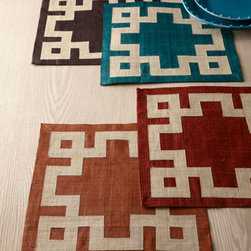 Four Greek Key Place Mats - I much prefer place mats over tablecloths — they have a more modern look and are much less trouble. These chic raffia place mats have a Greek key border and are available in four colors for a great look.