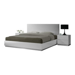J&M Furniture - J&M Naples Glossy White Lacquer Finish Queen Size Bedroom Set - The J&M Naples bedroom set is the perfect addition for any modern themed bedroom decor. Each piece comes in a stunning high gloss white lacquer finish. The bed features a large headboard with detail line design that add to the overall look. The case goods are crafted from solid wood products making them very durable and feature the matching white lacquer finish. The bedroom set shown comes with a queen size bed frame, two nightstands, a dresser, and mirror only. A mattress does NOT come included with the bed.