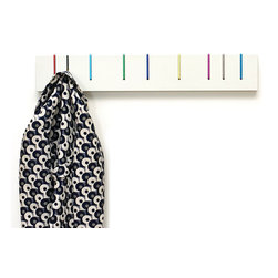 Symbol Coat Rack: Color - During the coat-less summer months the Symbol hangs as a purely aesthetic piece, as the hooks lay flat and belie their function. When needed, the hooks pull smoothly out to help you organize your stuff.
