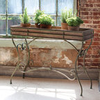 Potting Console Table - Superior design allows the beauty of the metal table base to shine while the planter box style insert does the work. Too pretty to relegate to the potting shed. Imagine it on the porch serving up bottles of wine or containers of sweet corn!