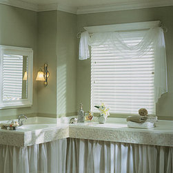 """Graber Lake Forest 2-1/2"""" Faux Wood Blinds - Graber Faux Wood Blinds simulate the deep, natural beauty of wood at a fraction of the cost. In addition, they're completely moisture-proof, making them an appropriate and attractive alternative for kitchens, bathrooms, laundry rooms and other rooms with high humidity. Faux wood blinds are an excellent choice for low-traffic areas of your home and other locations where budget is a consideration."""