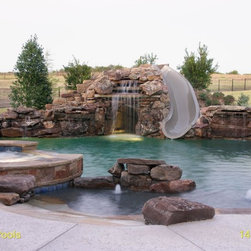 Dolphin's  Water Slides Installed by Claffey - Claffey Pools of Southlake, TX creates stunning pools and is a wonderful client that has installed hundreds of projects involving Dolphin Water Slides.