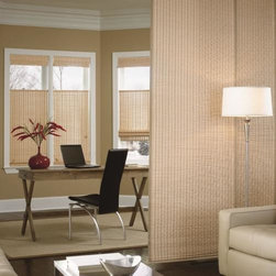 Bali Woven Wood Sliding Panels - Choose Bali Woven Wood Sliding Panels from Blinds.com to bring a sleek and modern look to your patio doors or larger windows. Also known as Panel Track, this product can also be used as a room divider or to cover a closet. With over dozens of natural material choices, you're sure find the perfect complement to your decor. These panels will slide effortlessly across a durable aluminum track. Personalize your look by choosing from a variety of panel sizes.