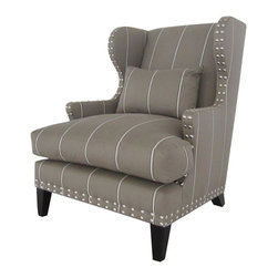 "Kathy Kuo Home - Amundsen British Industrial Studded Wing Back Arm Chair - This wingback chair has European style to spare but the nail head studded detailing throughout means it's not stuffy in the least. Dare we say ""edgy?""  With a silhouette inspired by French country and upholstered in a gray white striped fabric. This chair will be the envy of your guests.  This item is made to order in California upholstered in ""Grasset Storm"" cotton velvet fabric. Please allow up to 10 weeks lead time for construction.  COM options also available for same price."