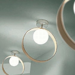 """Leucos - Leucos Giuko ceiling light - The Giuko ceiling light from Leucos has been designed by Works Studio in 2002-2005. This ceiling mounted luminaire is great for halogen lighting. The Giuko is constructed of a layered and blown satin finished glass diffuser. The structure of this light is composed of a ring in curved wood for the wood version and a plastic ring for the colored and chromed version, with elements in satined aluminum. The Giuko ceiling light exhibits a unique and stunning design, along with quality craftsmanship, that is sure to brilliantly illuminate any contemporary atmosphere.  Product Details:   The Giuko ceiling light from Leucos has been designed by Works Studio in 2002-2005. This ceiling mounted luminaire is great for halogen lighting. The Giuko is constructed of a layered and blown satin finished glass diffuser. The structure of this light is composed of a ring in curved wood for the wood version and a plastic ring for the colored and chromed version, with elements in satined aluminum. The Giuko ceiling light exhibits a unique and stunning design, along with quality craftsmanship, that is sure to brilliantly illuminate any contemporary atmosphere.  Details:      Manufacturer:     Leucos      Designer:    Works Studio      Made in:    Italy      Dimensions:     Height: 16 3/8"""" (41.5 cm) Width: 13.75"""" (35 cm)      Light bulb:     1 X 75W halogen      Material:     Glass, Aluminum, Wood or Plastic"""