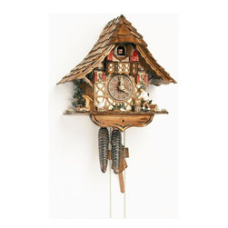 Schneider Cuckoo Clocks - 1-Day Black Forest House Cuckoo Clock w Hand Laid Shingles - Chalet style. 1-day rack strike movement. Wooden cuckoo, dial with roman numerals and hands. Individual handlaid shingles. Shut-off lever on left side of case silences strike, call and music. Wooden cuckoo and wood chopper calls, strikes and moves every half and full hour. Made from wood. Antique finish. Made in Germany. 10.2 in. W x 6.1 in. D x 10.8 in. H (4.9 lbs.). Care Instructions