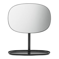 Normann Copenhagen - Flip Mirror by Normann Copenhagen - The Normann Copenhagen Flip Mirror flips up, down and rotates all around, letting you check out your reflection from all angles. It has a charming retro look due to its elongated rounded form, like an old TV screen. The base mimics the mirror's shape and has a raised lip, making it suitable for storing jewelry, make-up, etc. Normann Copenhagen is a Danish designer and manufacturer of high-quality modern home accessories, kitchen tools, glassware, tableware, furniture, lighting and more. Guided by the basic tenets of Scandivanian design, Normann Copenhagen offers a large array of products that feature a minimum of superfluous lines and regular use of natural materials. These pieces are further distinguished by modern bursts of color and functionality that is at once fresh and unique, yet uncomplicated and accessible.
