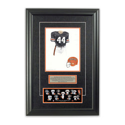 """Heritage Sports Art - Original art of the NFL 1975 Cincinnati Bengals uniform - This beautifully framed piece features an original piece of watercolor artwork glass-framed in an attractive two inch wide black resin frame with a double mat. The outer dimensions of the framed piece are approximately 17"""" wide x 24.5"""" high, although the exact size will vary according to the size of the original piece of art. At the core of the framed piece is the actual piece of original artwork as painted by the artist on textured 100% rag, water-marked watercolor paper. In many cases the original artwork has handwritten notes in pencil from the artist. Simply put, this is beautiful, one-of-a-kind artwork. The outer mat is a rich textured black acid-free mat with a decorative inset white v-groove, while the inner mat is a complimentary colored acid-free mat reflecting one of the team's primary colors. The image of this framed piece shows the mat color that we use (Orange). Beneath the artwork is a silver plate with black text describing the original artwork. The text for this piece will read: This original, one-of-a-kind watercolor painting of the 1975 Cincinnati Bengals uniform is the original artwork that was used in the creation of this Cincinnati Bengals uniform evolution print and tens of thousands of other Cincinnati Bengals products that have been sold across North America. This original piece of art was painted by artist Bill Band for Maple Leaf Productions Ltd. Beneath the silver plate is a 3"""" x 9"""" reproduction of a well known, best-selling print that celebrates the history of the team. The print beautifully illustrates the chronological evolution of the team's uniform and shows you how the original art was used in the creation of this print. If you look closely, you will see that the print features the actual artwork being offered for sale. The piece is framed with an extremely high quality framing glass. We have used this glass style for many years with excellent results. We"""