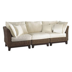 Panama Jack - Panama Jack Sanibel Sofa - Uniquely designed The Panama Jack Sanibel collection is just what sunroom or living room has been asking for. Durable and rich in tonal variation this chair is ideal for any relaxed living space. They have hand woven it over solid rattan frames to create furniture that will fit your needs. Combine with any other pieces from the Sanibel collection to create your own custom sectional specifically design to fit your needs. Pick any of our indoor or outdoor fabrics to create that custom look and feel your home desires. If you want to bring the casual relaxed feel of upscale tropical homes right to your living area or sunroom look no further.More than three decades ago the Original Panama Jack suncare products were quietly introduced on Florida's beaches. Word gets around in a beach town. Like the sand in their shoes and the sunset memories in their minds loyal locals and visitors alike took Panama Jack home with them to Main Street America and to the world. Since those early days Panama Jack established a following that extends far beyond stretches of pure white sand. Made with Love Care and Pride since 1974 Panama Jack is committed to bringing the feeling of escape fun adventure and the lifestyle of the tropics to people everywhere. They will continue to deliver products that provide you with even more freedom to enjoy what's most meaningful to you and your family.