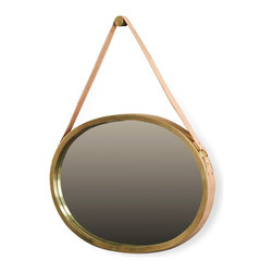 Kathy Kuo Home - Carradine Hollywood Regency Antique Brass Oval Hanging Mirror - Hang this handsome mirror in the bedroom, bathroom or hallway to reflect your exquisite taste and your smiling guests. Antique brass surrounds the oval mirror, hanging from a natural tan leather strap.