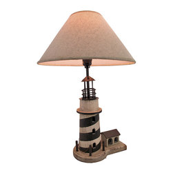 Zeckos - Cape Hatteras Lighthouse Table Lamp with Linen Shade - This table lamp adds the finishing touch to any room with a nautical theme. It measures 21 inches tall, and comes with a 14 inch diameter linen shade. The lamp has a 5 foot black power cord with a thumbwheel on/off switch, and uses up to 40 watt (max) type `A` bulbs (not included). The lamp is hand painted, has a wonderful distressed finish, and is sure to be admired.